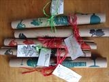 papers rolled with raffia tie and printed leaf labels by Susan Deakin, Artist Print, linocut